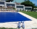 The PowerPlastics Solid Safety Cover with custom Rollup Station_ PowerPlastics Pool Covers